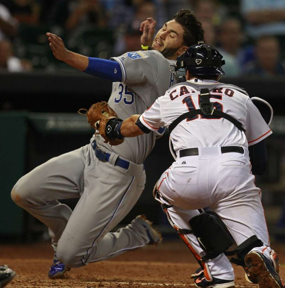 April 17: Royals 5, Astros 1  Astros catcher Jason Castro gets Eric Hosmer out on a play at the plate. Photo: Melissa Phillip, Houston Chronicle