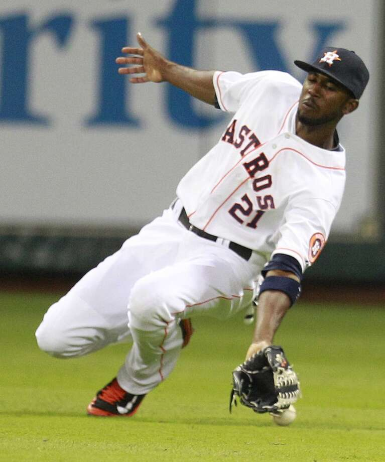 Astros center fielder Dexter Fowler misses catch on a double hit by Salvador Perez. Photo: Melissa Phillip, Houston Chronicle