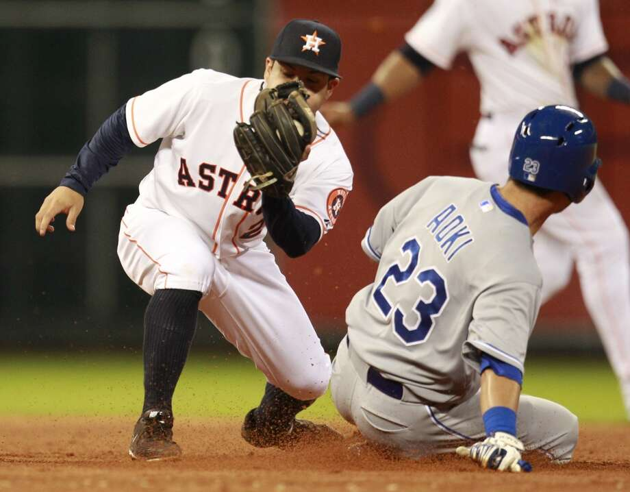 Astros second baseman Jose Altuve cannot catch Nori Aoki on a steal attempt. Photo: Melissa Phillip, Houston Chronicle