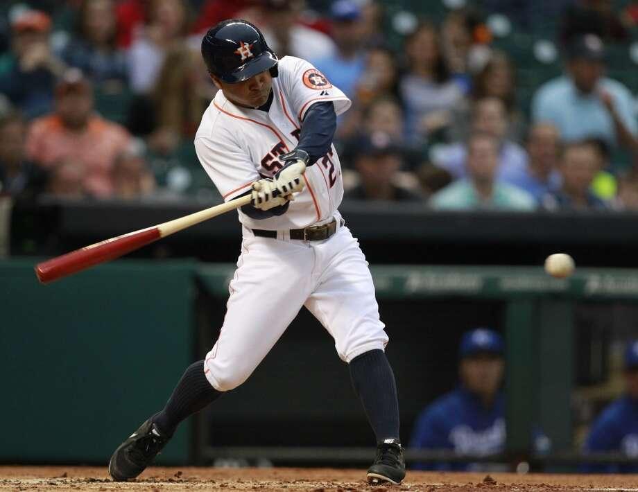 Jose Altuve hits a single. Photo: Melissa Phillip, Houston Chronicle