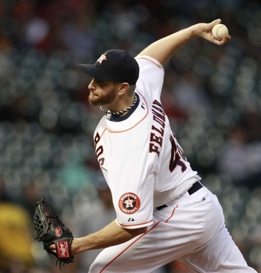 Scott Feldman pitches. Photo: Melissa Phillip, Houston Chronicle