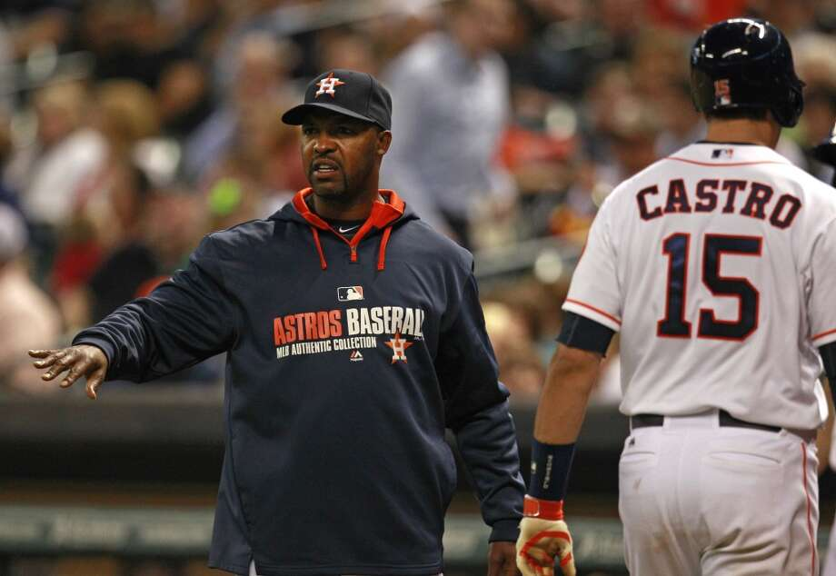Astros manger Bo Porter comes out of the dugout to comment to home plate umpire CB Bucknor after Jason Castro is called out on strikes. Photo: Melissa Phillip, Houston Chronicle
