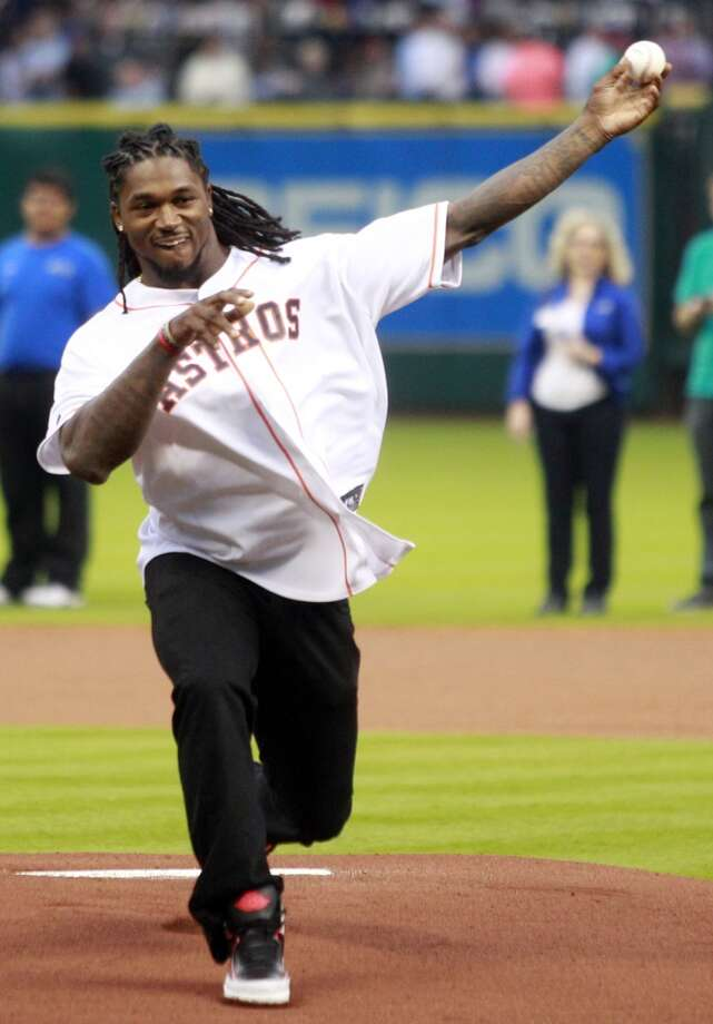 Texans player D.J. Swearinger throws out the first pitch. Photo: Melissa Phillip, Houston Chronicle