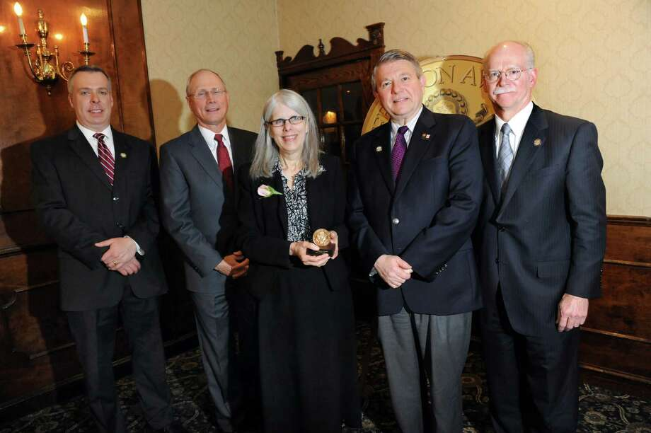 Jefferson Award medalist Mary O'Keefe, center, joins, from left, Jason Gough of News Channel 13, Dr. James Reed of St. Peter's Health Partners, Stephen Baboulis of WNYT and WNYA and George R. Hearst III of the Times Union during the awards ceremony on Thursday, April 17, 2014, at the Century House in Latham, N.Y. (Cindy Schultz / Times Union) Photo: Cindy Schultz / 00026335A