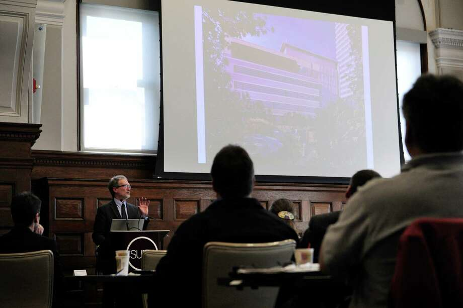 Doug Johnston, chair of the Department of Landscape Architecture, SUNY College of Environmental Science and Forestry gives a lecture at the  State University of New York Green Infrastructure Summit on Thursday, April 17, 2014, in Albany, N.Y.  The event featured lectures on the tools and programs available and the challenges of using green infrastructure to deal with storm water management.    (Paul Buckowski / Times Union) Photo: Paul Buckowski / 00026543A