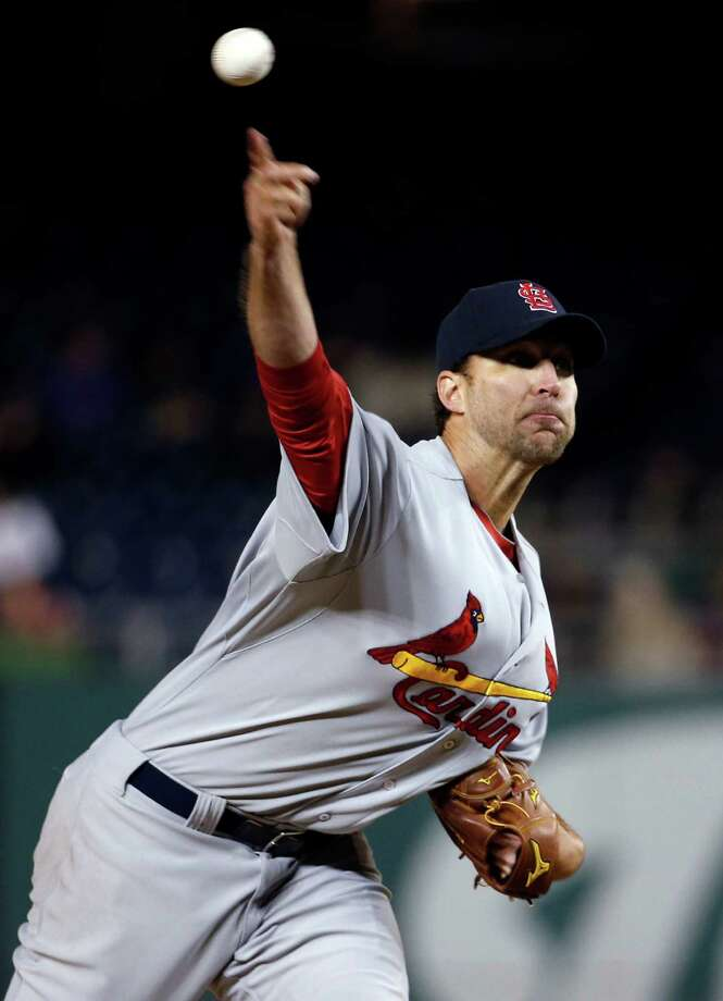St. Louis Cardinals starting pitcher Adam Wainwright throws during the eighth inning of a baseball game against the Washington Nationals at Nationals Park on Thursday, April 17, 2014, in Washington. Wainwright threw a two-hitter as St. Louis won 8-0. (AP Photo/Alex Brandon) ORG XMIT: NAT118 Photo: Alex Brandon / AP