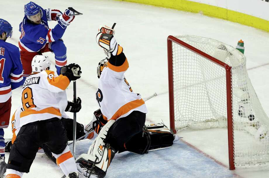 New York Rangers' Derek Stepan (21) shoots the puck past Philadelphia Flyers goalie Ray Emery (29) during the third period in Game 1 of an NHL hockey first-round playoff series on Thursday, April 17, 2014, in New York. The Rangers won the game 4-1. (AP Photo/Frank Franklin II) ORG XMIT: MSG117 Photo: Frank Franklin II / AP
