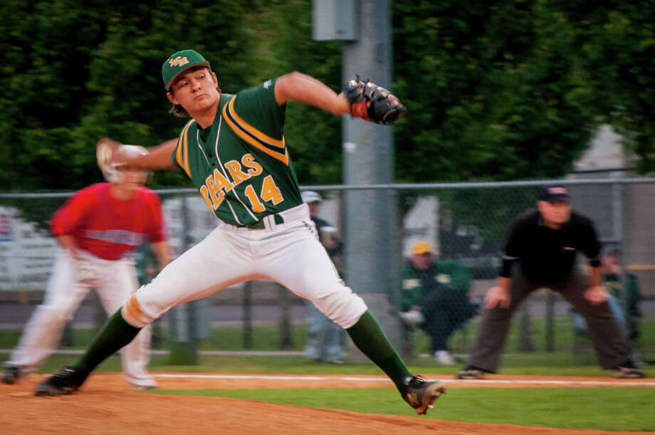 Coby R. of Little Cypress-Mauriceville pitches during a matchup against the Lumberton Raiders Thursday night at the LCM field. Photograph by Michael Reed. Photo: Michael Reed / Michael Reed
