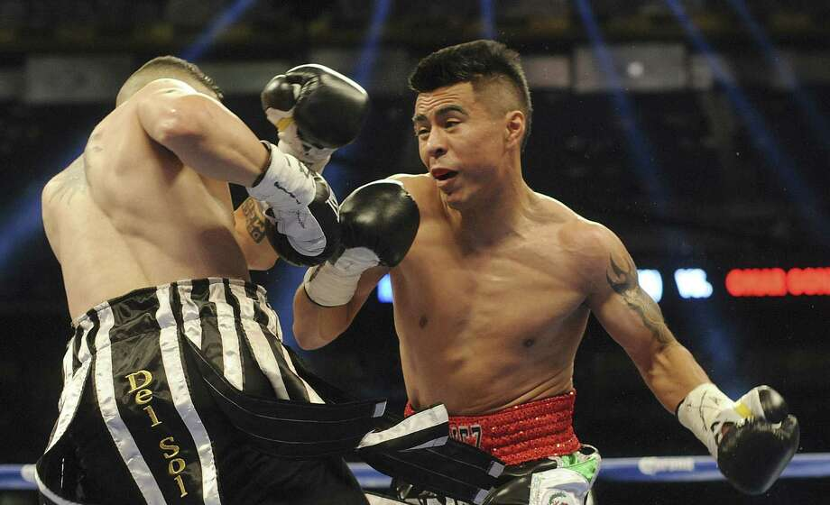 "San Antonio bantamweight Raul Martinez (right), 32, has fought injuries for years. ""My body will tell me when it's time to quit,"" he says. ""Right now, my heart tells me I have a lot left."" Photo: Billy Calzada / San Antonio Express-News / San Antonio Express-News"