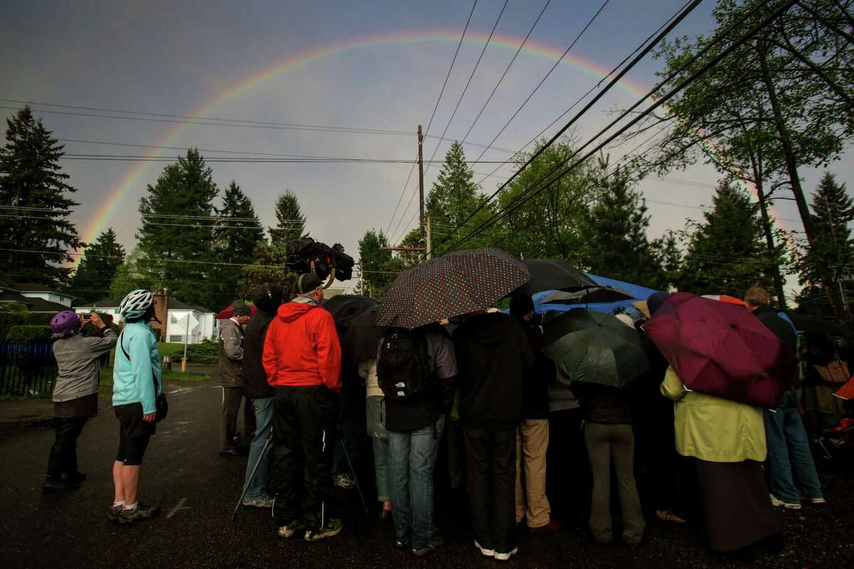 A double rainbow arcs overhead during a vigil for Sandhya Khadka, a 17 year-old student killed while crossing 5th Avenue Northeast while on her way to school at North Seattle Community College. She was hit by a truck while crossing near Northeast 115th Street. Photographed on Thursday, April 17, 2014.