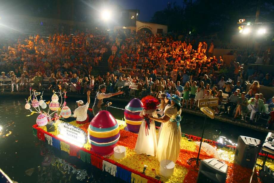 "FOR METRO - The Battle of Flowers Association float with the theme ""Easter Parade"" passes through the Arneson River Theatre during the Texas Cavaliers River Parade Monday April 21, 2008. (PHOTO BY EDWARD A. ORNELAS/STAFF) Photo: Edward A. Ornelas, Express-News"