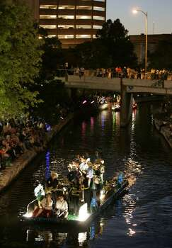 METRO; RIVER PARADE JMS; 04/20/09; Thousands of visitors and residents catch the Fiesta spirit and watch the Texas Cavaliers River Parade, Monday evening, April 20, 2009, along San Antonio's Riverwalk. ( Photo by J. Michael Short / SPECIAL ) Photo: J. Michael Short, Special To Express-News