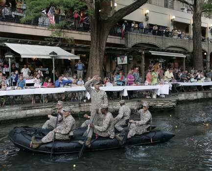 Soldiers from Fort Sam Houston paddle their way past thethousands of visitors and residents That caught the Fiesta spirit during the Texas Cavaliers River Parade, Monday evening, April 20, 2009, along San Antonio's Riverwalk. ( Photo by J. Michael Short / SPECIAL ) Photo: J. Michael Short, Special To Express-News