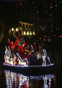 METRO The Texas Cavaliers float lights up the river. 2009 Holiday River Parade in San Antonio on Nov. 27, 2009. Tom Reel/Staff Photo: Tom Reel, Express-News