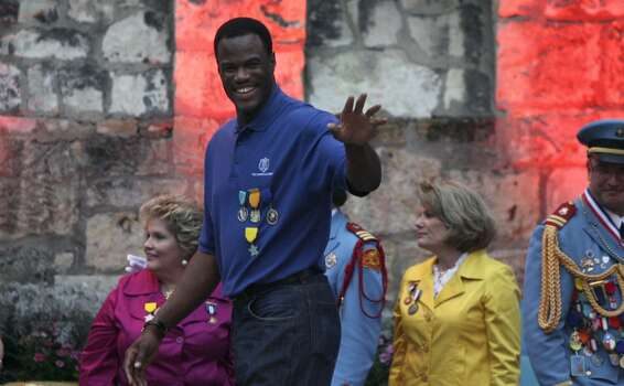 Spurs great David Robinson, grand marshal of the Texas Cavaliers' River Parade, waves to the crowd at the River Parade Monday. JOHN DAVENPORT/jdavenport@express-news.net Photo: John Davenport, Express-News