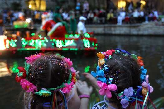 Lauren Hale, 6, left, and Olivia Knox, 5, wave at a passing float during the Texas Cavaliers River Parade, Monday, April 19, 2010. Jennifer Whitney/ special to the Express-News Photo: Jennifer Whitney, Special To Express-News