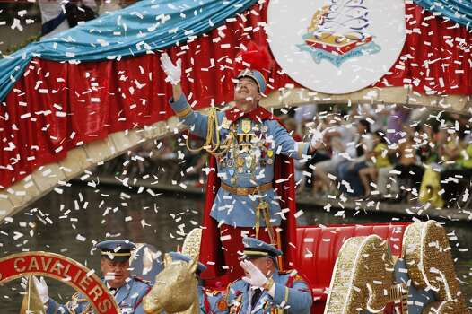 METRO -- King Antonio LXXXIX Bill Mitchell looks up at the confetti as he and his aides enter the Arneson River Theatre during the 80th annual Texas Cavalier River Parade, Monday, April 11, 2011. JERRY LARA/glara@express-news.net Photo: Jerry Lara, Express-News