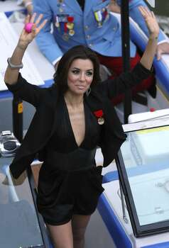 FOR METRO - Grand Marshal Eva Longoria waves to spectators during the Texas Cavaliers' River Parade Monday April 11, 2011. (PHOTO BY EDWARD A. ORNELAS/eaornelas@express-news.net) Photo: Edward A. Ornelas, Express-News