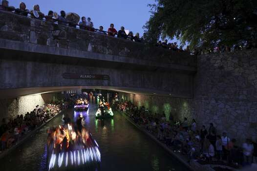 FOR METRO - Specators watch floats pass during the Texas Cavaliers' River Parade Monday April 11, 2011. (PHOTO BY EDWARD A. ORNELAS/eaornelas@express-news.net) Photo: Edward A. Ornelas, Express-News