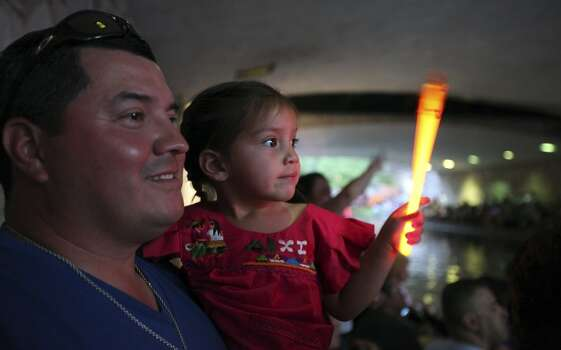 FOR METRO - George Valdez and his daughter Cattalina Valdez, 3, watch the Texas Cavaliers' River Parade Monday April 11, 2011. (PHOTO BY EDWARD A. ORNELAS/eaornelas@express-news.net) Photo: Edward A. Ornelas, Express-News