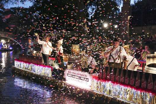 """Confetti fills the air as Beethoven Maennerchor's """"Beer Barrel Polka"""" float passes during the 2012 Texas Cavaliers' River Parade """"Rockin' on the River"""" Monday April 23, 2012. (PHOTO BY EDWARD A. ORNELAS/SAN ANTONIO EXPRESS-NEWS) Photo: Edward A. Ornelas, Express-News"""