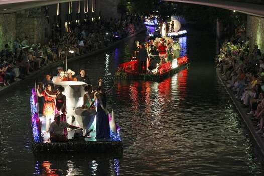 """FOR METRO - Floats passes under Alamo Street during the 2012 Texas Cavaliers' River Parade """"Rockin' on the River"""" Monday April 23, 2012. (PHOTO BY EDWARD A. ORNELAS/SAN ANTONIO EXPRESS-NEWS) Photo: Edward A. Ornelas, Express-News"""