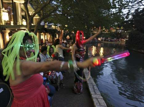 """FOR METRO - Gloria Alonzo (left) waves as a float passes during the 2012 Texas Cavaliers' River Parade """"Rockin' on the River"""" Monday April 23, 2012. (PHOTO BY EDWARD A. ORNELAS/SAN ANTONIO EXPRESS-NEWS) Photo: Edward A. Ornelas, Express-News"""