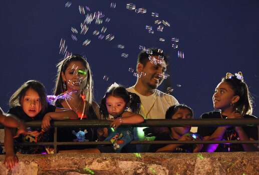 """Gisele Cabrera, 7, (from left), Mishel Gamez, Shilo Bertadillo, 2, David Bertadillo, Joe Cabrera, 9, and Absidee Cabrera,11, take in the sights during the 2012 Texas Cavaliers' River Parade """"Rockin' on the River"""" Monday April 23, 2012. Photo: Edward A. Ornelas, Express-News"""