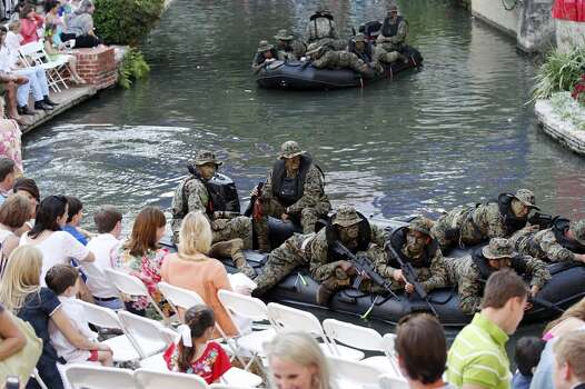 """Members of the 4th Reconnaissance Battalion pass through the Arneson River Theatre during the 2012 Texas Cavaliers' River Parade """"Rockin' on the River"""" Monday April 23, 2012. (PHOTO BY EDWARD A. ORNELAS/SAN ANTONIO EXPRESS-NEWS) Photo: Edward A. Ornelas, Express-News"""