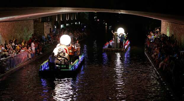 """Floats pass under South Alamo Street during the Texas Cavaliers River Parade """"Stars on the River"""" held Monday April 22, 2013. Photo: Edward A. Ornelas, Express-News"""
