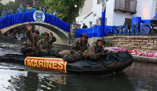 """Members of the United States Marine Corps 4th Reconnaissance Battalion pass through the Arneson River Theatre during the Texas Cavaliers River Parade """"Stars on the River"""" held Monday April 22, 2013. Photo: Edward A. Ornelas, Express-News"""