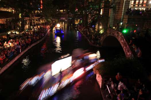 """Floats make their way along the Riverwalk during the Texas Cavaliers River Parade """"Stars on the River"""" held Monday April 22, 2013. Photo: Edward A. Ornelas, Express-News"""