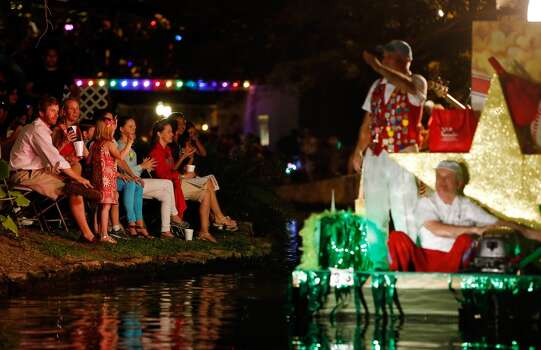 """Spectators watch the TEAMability's """"All Stars"""" float pass during the Texas Cavaliers River Parade """"Stars on the River"""" held Monday April 22, 2013. Photo: Edward A. Ornelas, Express-News"""