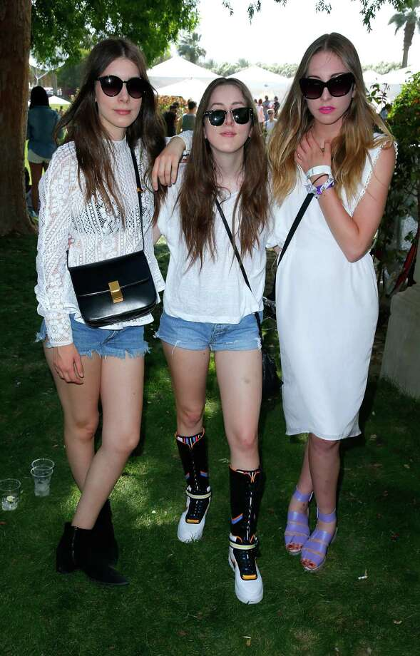 Alana Haim, Danielle Haim and Este Haim at the Lacoste Beautiful Desert Pool Party held in conjunction with Coachella in Thermal, Calif.  Photo: Joe Scarnici, Getty Images For LACOSTE / 2014 Getty Images