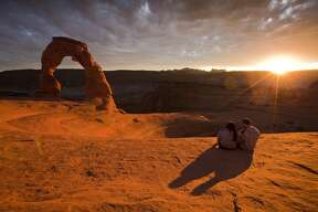 Catch a sunset at Arches National Park (Utah), home to more than 2,000 arches.