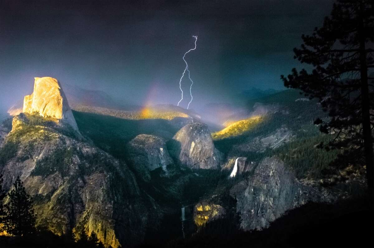 As the 16th largest National Park in the United States, Yosemite covers 1,100 square miles of virgin nature. Yosemite occasionally provides moments of surreal, beautiful photography; in 2006, photographer Nolan Nitschke took this photo of a lightning crashing through a rainbow during a storm.