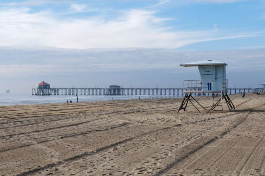 File photo of Huntington Beach, Calif. A waiter at Saint Marc restaurant in Huntington Beach was fired after asking four Latina women for proof of residency. Photo: Sergio Pitamitz, Getty Images/Purestock