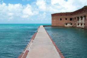 The crystal-clear waters of  Dry Tortugas National Park  (Florida), located 70 miles west of Key West, teem with marine life.