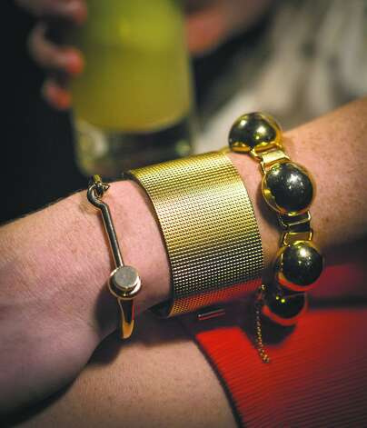 Adair H.'s arm party features a mod half-sphere bracelet $22, from Pretty Penny; Celine mesh cuff , $790, and Celine hook bracelet, $690, both Barneys New York. Photo: Russell Yip, The Chronicle