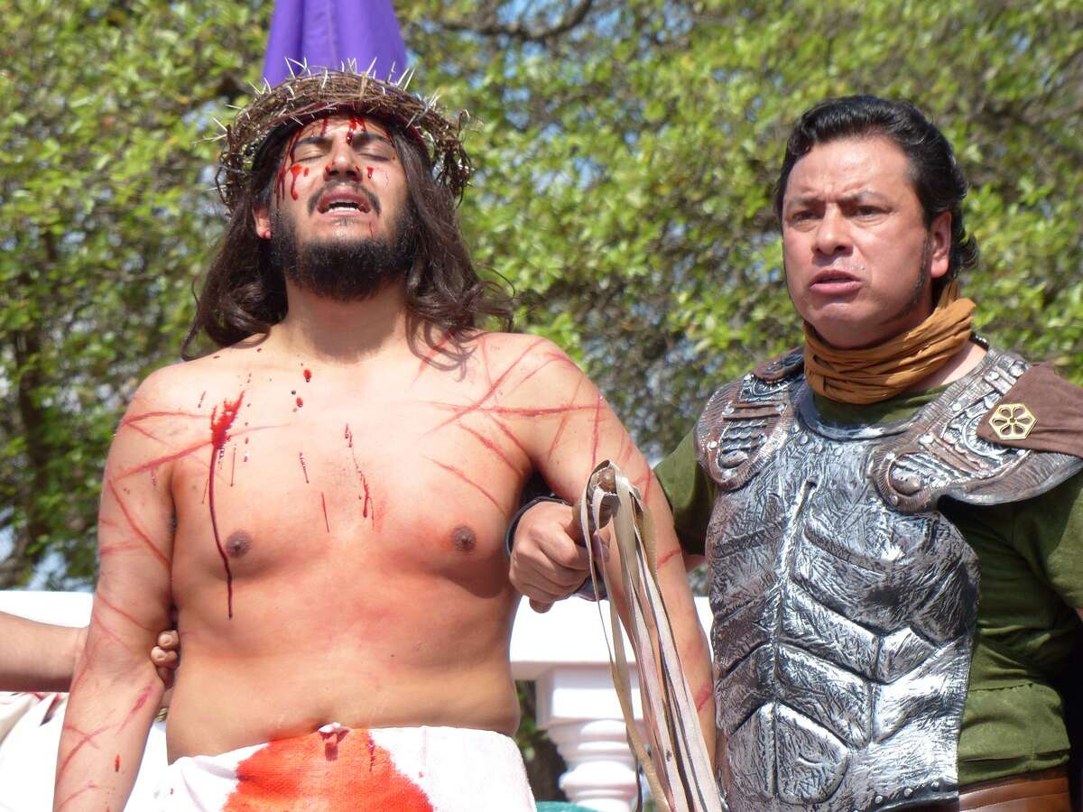 Jesus, portrayed by Jose Niño, is handed over for crucifixion during the re-enactment of the Passion of the Christ on April 18, 2014.