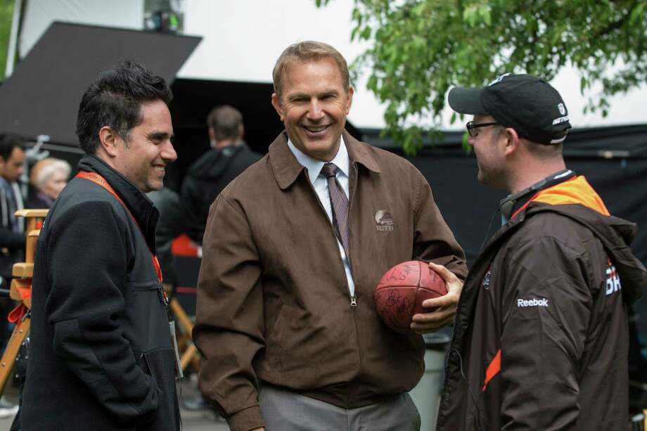 "This image released by Summit Entertainment shows Rajiv Joseph, left, Kevin Costner, center, and Scott Rothman in a scene from ""Draft Day."" (AP Photo/Summit Entertainment, Dale Robinette) Photo: Dale Robinette, Associated Press / Associated Press"