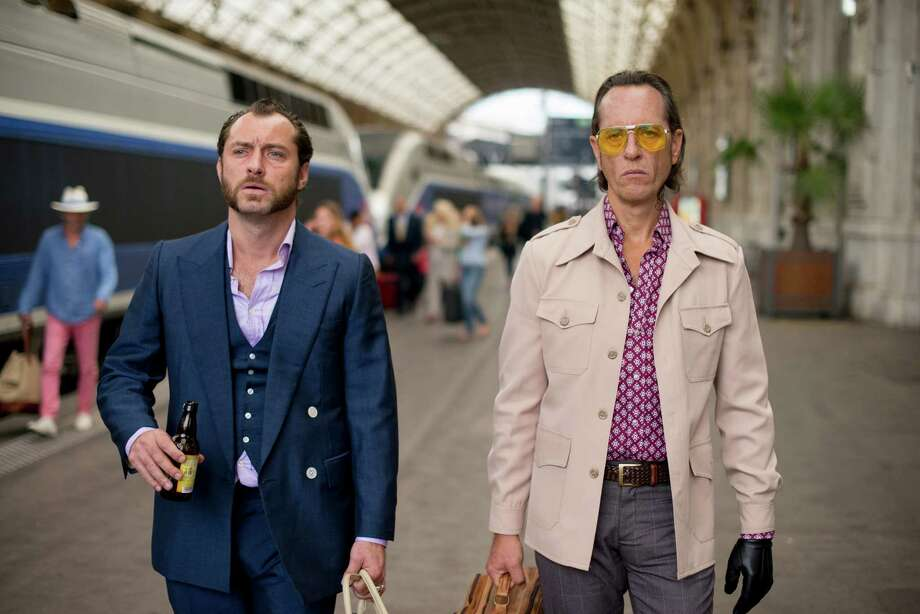 "This image released by Fox Searchlight Pictures shows Jude Law, left, and Richard E. Grant in a scene from ""Dom Hemingway."" (AP Photo/Fox Searchlight Pictures, Nick Wall) Photo: Nick Wall, Associated Press / Associated Press"