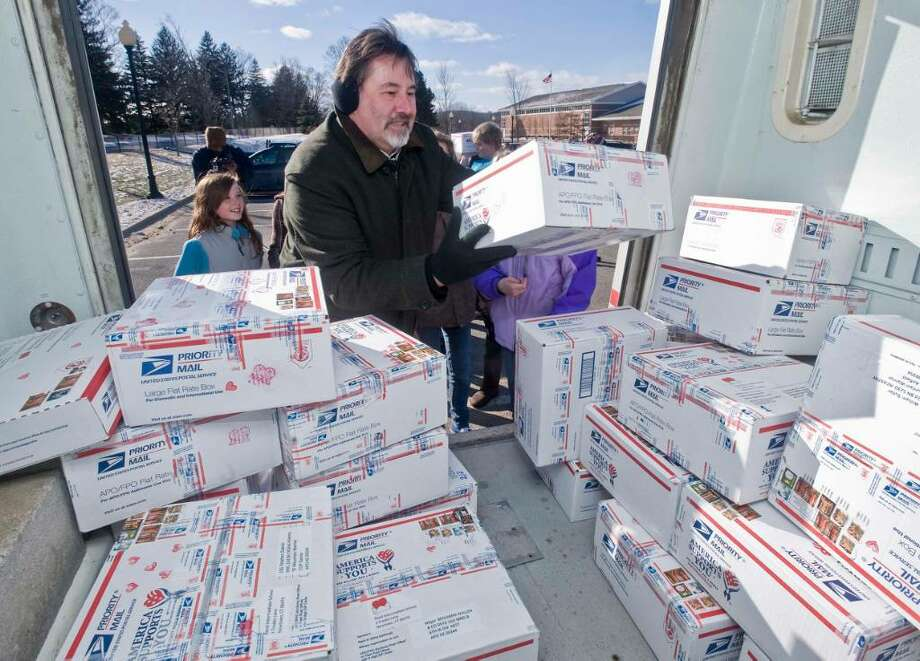 Hawleyville Postmaster Mark Favale loads the Valentine's Day boxes into the mail truck from the kids at Reed Intermediate School, to be delivered to the soldiers abroad. Friday, Jan. 29, 2010 Photo: Scott Mullin / The News-Times