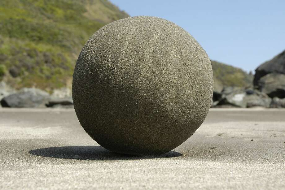 Environmental artist Zach Pine says a beginner can make a grapefruit-size sand globe in 10 minutes. Photo: Zach Pine