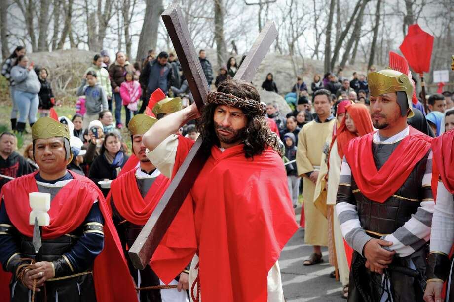 Marvin Ramos as Jesus and parishioners from St Benedict - Our Lady of Montserrat and St. Mary's follow the stations of the cross in a procession from Cummings Park to St. Mary's in Stamford, Conn. on Friday April 18, 2014. Photo: Dru Nadler / Stamford Advocate Freelance
