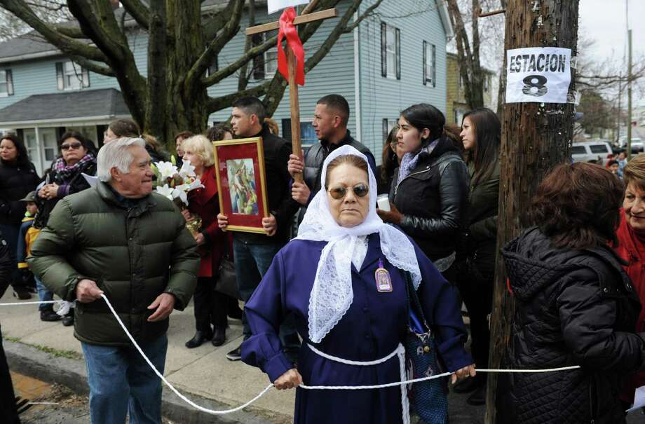 Parishioners from St Benedict - Our Lady of Montserrat and St. Mary's follow the stations of the cross in a procession from Cummings Park to St. Mary's in Stamford, Conn. on Friday April 18, 2014. Photo: Dru Nadler / Stamford Advocate Freelance