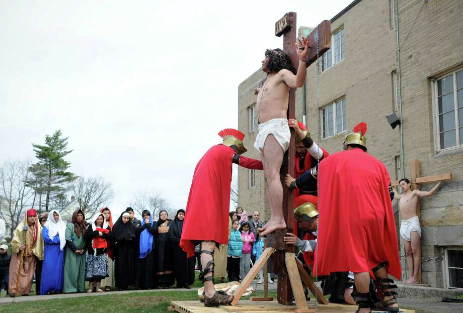 The parishes of St Benedict -Our Lady of Montserrat and St. Mary's follow the living stations of the cross procession from Cummings Park to St. Mary's in Stamford, Conn. on Friday April 18, 2014. Photo: Dru Nadler / Stamford Advocate Freelance