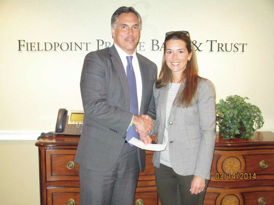 Bob Matthews, President of Fieldpoint Private Bank, recently presented a sponsorship check for the Greenwich Tree Conservancyís Tree Party, to Tree Party Co-Chairwoman, Ashley Allan. The party will take place on Friday, April 25 (Arbor Day) from 6:30-8:30 PM at McArdles Greenhouse and is open to the public. Tickets can be purchased online at www.greenwichtreeconservancy.org. Photo: Contributed Photo / Greenwich Time Contributed