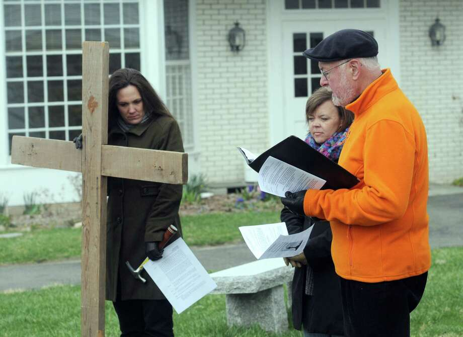 The Passion and death of Jesus Christ is remembered Friday, April 18, 2014, with an ecumenical Good Friday Cross Walk led by area clergy in Brookfield, Conn. Starting and ending at the Brookfield Congregational Church, worshippers took turns carrying the cross, singing hymns and listening to short observances along the way. Easter, when the resurrection of Christ is celebrated, is Sunday. Photo: Carol Kaliff / The News-Times