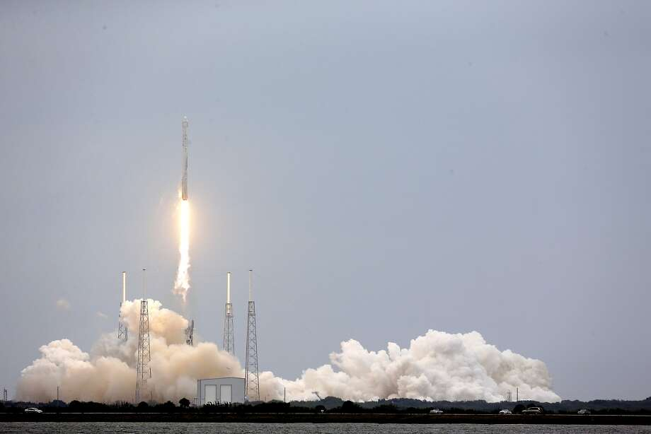 The SpaceX rocket lifts off from its launch pad in Cape Canaveral. The Dragon cargo ship will deliver research equipment, food and other supplies. Photo: John Raoux, Associated Press